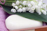 Stock Photo of Spa setting of towels, soap and lilies of the valley