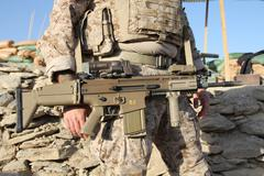 Navy SEAL holding SCAR-17 battle rifle Stock Photos