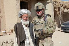 Army soldier with a muslim old man (editorial) - stock photo