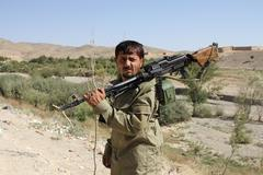 Afghan soldier holding a machine gun (editorial) Stock Photos