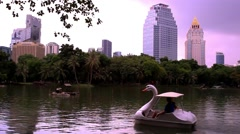 Bangkok city view. Public Garden. Catamaran in pond. HD. 1920x1080 Stock Footage