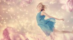Beautiful woman in a pink peony flower fantasy Stock Photos