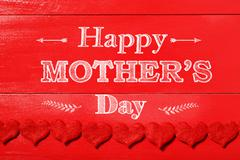 Happy Mothers Day message with red felt hearts - stock photo
