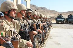 Afghan Soldiers in formation with weapons - stock photo
