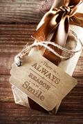 There is always a reason to smile message card on earth tone gift box Stock Photos
