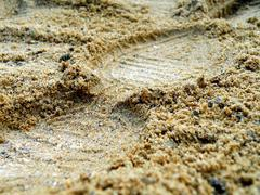 Foot in sand Stock Photos