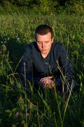 Young Man Sitting on the Grass Stock Photos