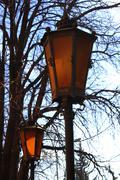 Retro street lamp shining at the twilight - stock photo