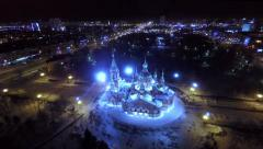 Orthodox church in the city center at night. Aerial shot. Stock Footage