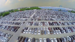 Many vehicles on parking for new cars at summer cloudy day. Stock Footage