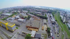 Cityscape with railroad near concrete plant and large parking Stock Footage