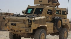 U.S. military vehicle arriving the base at Afghanistan - stock footage