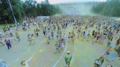 Crowd of young people celebrate holiday of indian paints Holi Stock Footage