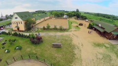 People walk by modern ranch at summer day. Aerial view. Stock Footage