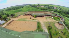Modern ranch near village at summer day. Aerial view. Stock Footage