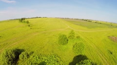 Large grazing near village at summer sunny day. Aerial view Stock Footage