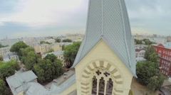 Cross on top of belltower of Evangelical Lutheran Cathedral - stock footage