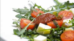 Arugula with cheese and tomatoes Stock Footage