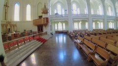 Altar and wooden pews in hall of Evangelical Lutheran Cathedral Stock Footage