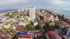 Panorama of coastal town with hotels on sea shore at summer Stock Footage