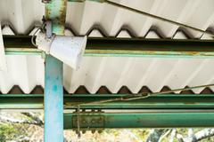 Loudspeaker was installed at the train platform - stock photo