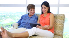Hispanic latino Daughter and Mother Watching tablet - stock footage