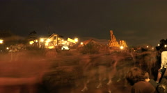 4k Night time lapse of crowds at amusement park Stock Footage
