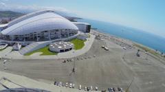 Fisht Olympic Stadium on sea shore at summer sunny day Stock Footage