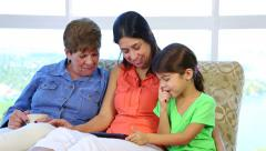Hispanic latino grandma, daughter and granddaughter with tablet - stock footage