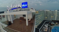 Edifice of Radisson Blu hotel with signboard on roof at summer Stock Footage