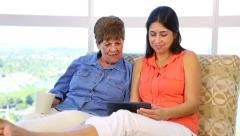 Hispanic latino Mother and daughter on sofa - stock footage