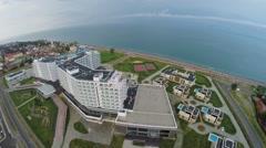 Flash of lightning above sea with hotel Radisson Blu on shore - stock footage