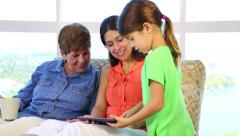 Hispanic latino Daughter showing her tablet to mother and gdrandmother - stock footage