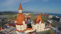 Hotel Bogatyr near Sochi-park at summer sunny day. Aerial view Stock Footage