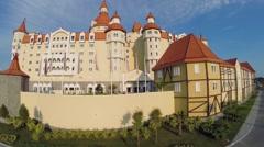 Hotel Bogatyr near amusement park at summer sunny day. Stock Footage