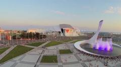 Tourists watch fountain with illumination near sports stadiums Stock Footage