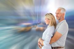 Composite image of happy couple smiling and embracing Stock Illustration