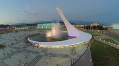 Panorama of square with colorful fountain and sports stadiums Stock Footage