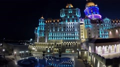 Pool near edifice of hotel Bogatyr with illumination at summer Stock Footage