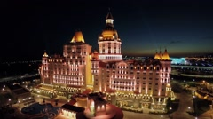 Edifice of hotel Bogatyr with illumination and olympic complex Stock Footage