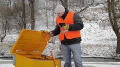 Worker with tablet PC near the sandbox in winter Stock Footage