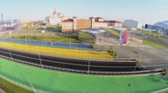 Five color pedestrians bridges near Sochi-park and hotel Bogatyr Stock Footage