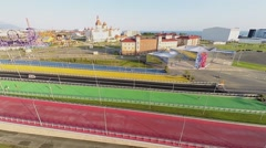 People walk and buses ride by color roads near Sochi-park Stock Footage