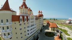 Edifice of hotel Bogatyr near sea shore at summer Stock Footage