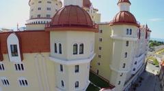 Facade of hotel Bogatyr near at summer sunny day. Stock Footage