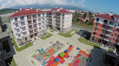 Houses with playground in town-hotel Barhatnye Sezony Stock Footage