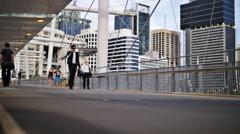 Pedestrians over Kurilpa Bridge in Brisbane TL 4K Stock Footage