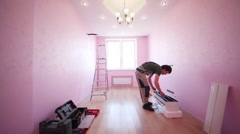 Worker is preparing to install the air conditioner Stock Footage