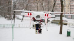 Quadrocopter drone flies on the street with mounted two GoPro Hero Stock Footage