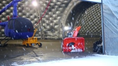 Snowblower and two helicopters in the hangar of Heliport Moscow Stock Footage